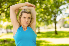 Fit blonde stretching in the park Stock Photography