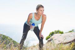 Fit blonde taking a break at summit Stock Image