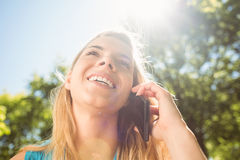 Fit blonde talking on her smartphone Stock Photography