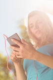 Fit blonde texting on her smartphone Stock Photos