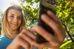 Fit blonde texting on her smartphone Royalty Free Stock Photography