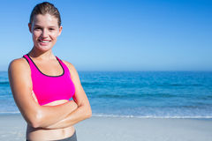 Fit blonde woman standing arms crossed Stock Photos