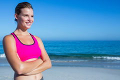 Fit blonde woman standing arms crossed Royalty Free Stock Photos