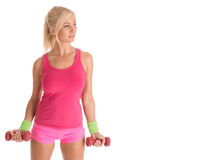 Fit blonde woman standing with dumbbells Royalty Free Stock Photos