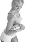 Fit blonde woman training with dumbbells Stock Photography