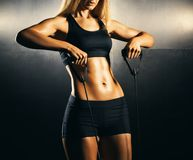 Fit body of beautiful, healthy and sporty girl. Slim woman posing in sportswear. Fit body of beautiful, healthy and sporty woman. Slim woman posing in Stock Photos