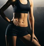 Fit body of beautiful, healthy and sporty girl. Slim woman posing in sportswear. Royalty Free Stock Photos