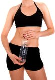 Fit body with a water bottle Royalty Free Stock Photo