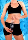 Fit body with a water bottle Stock Image
