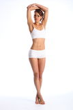 Fit body of young healthy woman arms over head Royalty Free Stock Photo