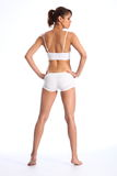 Fit body of young healthy woman in white underwear Stock Photography