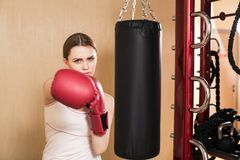 Fit box. Photo of sexy woman in a gym club doing fit box Royalty Free Stock Photo
