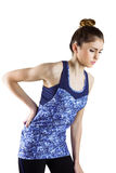 Fit brunette with back injury Royalty Free Stock Photo