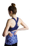 Fit brunette with back injury Royalty Free Stock Photos