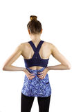 Fit brunette with back injury Stock Photo