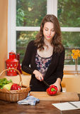 Fit brunette beauty and healthy food. Royalty Free Stock Photo