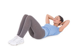 Fit brunette doing sit ups Stock Photography