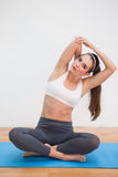Fit brunette doing yoga at home royalty free stock photos