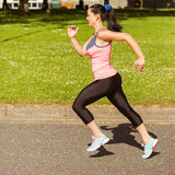 Fit brunette going faster on path Stock Image
