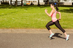 Fit brunette going faster on path Royalty Free Stock Image