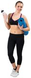 Fit brunette holding mat and sports bottle Royalty Free Stock Photo