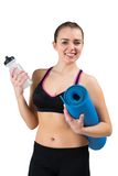 Fit brunette holding mat and sports bottle Royalty Free Stock Images