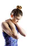 Fit brunette with neck injury. On white background stock photos