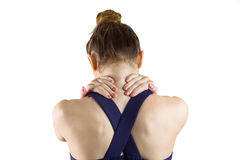 Fit brunette with neck injury. On white background royalty free stock images