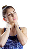 Fit brunette with neck injury. On white background royalty free stock image
