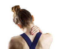 Fit brunette with neck injury. On white background royalty free stock photography