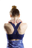 Fit brunette with neck injury. On white background stock images
