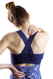 Fit brunette with neck injury. On white background stock photo