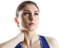 Fit brunette with neck injury Stock Photo