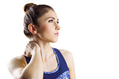 Fit brunette with neck injury. On white background stock image