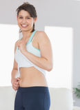 Fit brunette pinching her stomach Stock Image