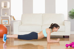 Fit brunette in plank position Stock Image