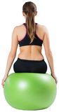 Fit brunette sitting on exercise ball Royalty Free Stock Image
