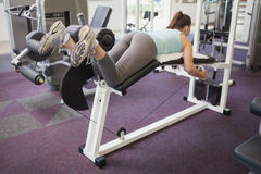 Fit brunette using weights machine for legs Stock Photo