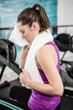 Fit brunette wiping sweat with towel Royalty Free Stock Images