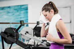 Fit brunette wiping sweat with towel Stock Photo
