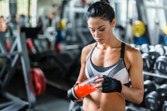 Fit Brunette Woman Refreshing after Training Royalty Free Stock Photos