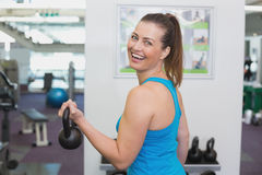 Fit brunette working out with kettlebell Stock Image