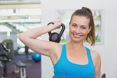 Fit brunette working out with kettlebell Stock Photo