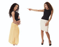 A fit business woman in a skirt points with shock at a pregnant Stock Images