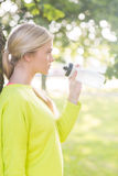 Fit calm blonde holding water bottle Stock Image