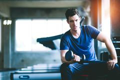 Fit caucasian handsome young man and big muscle in sportswear. stock photography