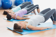 Fit class exercising at fitness studio Stock Photography
