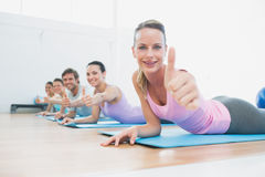 Fit class gesturing thumbs up at fitness studio Royalty Free Stock Images