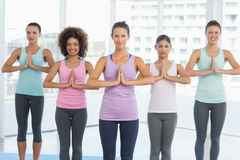 Fit class with hands joined at fitness studio Stock Images