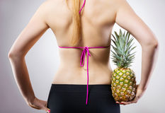 Fit concept with pineapple Stock Photos